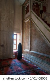 Edirne, Turkey - 10 May, 2019: Woman pray in The Old Mosque (Turkish: Eski Camii or Ulu Cami). An early 15th century Ottoman mosque. Order of Emir Suleyman, one of the sons of Beyazit