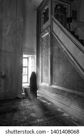 Edirne, Turkey - 10 May, 2019: Woman pray in The Old Mosque (Turkish: Eski Camii or Ulu Cami). An early 15th century Ottoman mosque. Order of Emir Suleyman, one of the sons of Beyazit. Black and white