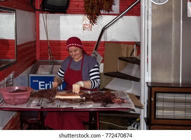 Edirne, Turkey- December, 03,  2017: woman cut beef liver in her store to prepare Ciger Tava or Arnavut Cigeri