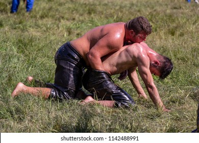 EDIRNE, TURKEY - JULY 14, 2018: Oil wrestlers compete during Kirkpinar Festival. Oil wrestling also called grease wrestling is the Turkish traditional sport.