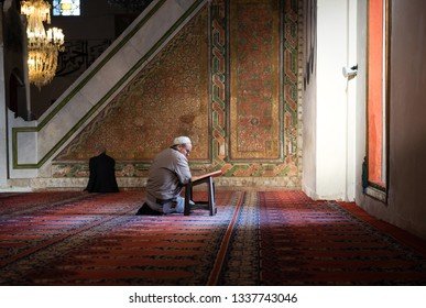 EDIRNE - TURKEY, MARC 9: Undefined Muslim reading the Quran in Edirne Old Mosque on March 9, 2019. The Old Mosque is an early 15th century Ottoman mosque in Edirne, Turkey