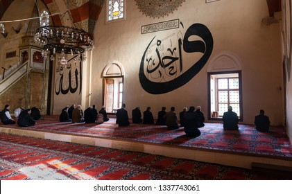 EDIRNE - TURKEY, MARC 9: Undefined muslims praying in Edirne Old Mosque on March 9, 2019. The Old Mosque is an early 15th century Ottoman mosque in Edirne, Turkey