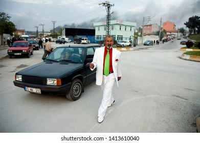 Edirne, Turkey - May 05, 2006 : A Roma Sinti Gypsy man wearing White suit having fun in Edirne Kemikciler quarter, on Kakava Hidrellez. Hidrellez is a very old anatolian traditional spring celebration