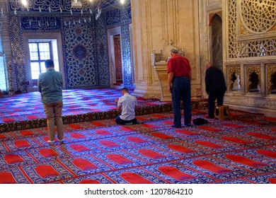 EDIRNE, TURKEY - MAY 2, 2018 -Men at afternoon prayer in Sinan's Selimiye Mosque, 16th century,  in Edirne,Turkey