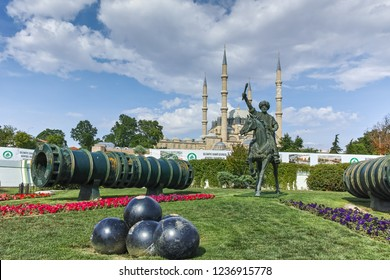 EDIRNE, TURKEY - MAY 26, 2018:  Selimiye Mosque and monument of Ottoman Sultan Mehmed II with medieval cannon in city of Edirne,  East Thrace, Turkey