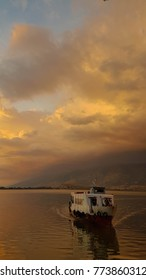 EDIRORIAL: BOAT, 12 OCTOBER 2017 , IOANNINA CITY,GREECE, boat sunset colors in lake Pamvotis of Ioannina city Greece