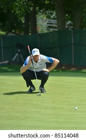 EDISON, NJ- AUGUST 24: Golfer Jim Furyk lines up his putt during the Barclays pro-am held at the Plainfield Country Club on August 24, 2011 in Edison, NJ.