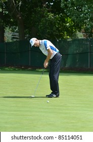 EDISON, NJ- AUGUST 24: Golfer Jim Furyk putts during the Barclays pro-am held at the Plainfield Country Club on August 24, 2011 in Edison, NJ.
