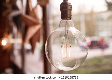 Edison retro glass lamp included light, in background cardboard star, loft style.