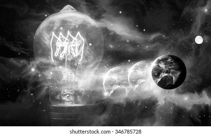 Edison style light bulb and planet earth against beautiful universe, Elements of image provided by NASA
