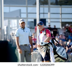 EDISON,NEW JERSEY - AUGUST 28,2015: Jason Day (L) takes a look at the green with his caddie during the second round of the Barclays Tournament held at the Plainfield Country Club in Edison,New Jersey.