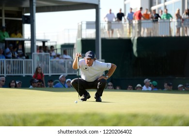 EDISON,NEW JERSEY - AUGUST 28,2015: Phil Mickelson lines up his putt during the second round of the Barclays Tournament held at the Plainfield Country Club in Edison,New Jersey.