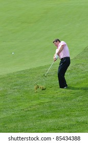 EDISON,NJ-AUGUST 24: Barclays CEO Robert Diamond takes a shot from the rough during the Barclays pro-am held at the Plainfield Country Club on August 24,2011 in Edison,NJ.