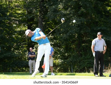 EDISON,NJ-AUGUST 25:Dustin Johnson (L) drives his ball down the fairway during the Barclays Tournament practice rounds held at the Plainfield Country Club in Edison,NJ,August 25,2015.