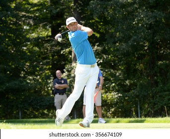 EDISON,NJ-AUGUST 25:Dustin Johnson watches his shot during the Barclays Tournament practice round held at the Plainfield Country Club in Edison,NJ,August 25,2015.