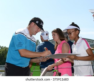 EDISON,NJ-AUGUST 25:Jason Bohn signs autographs for his fans during the Barclays Tournament practice round held at the Plainfield Country Club in Edison,NJ,August 25,2015.