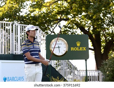 EDISON,NJ-AUGUST 26:Kevin Na watches his shot during the Barclays Pro-Am held at the Plainfield Country Club in Edison,NJ,August 26,2015.