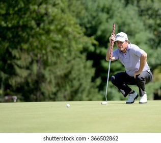 EDISON,NJ-AUGUST 28:Tim Clark lines up his putt on the 18th hole during the second round of the Barclays Tournament held at the Plainfield Country Club in Edison,NJ,August 28,2015.