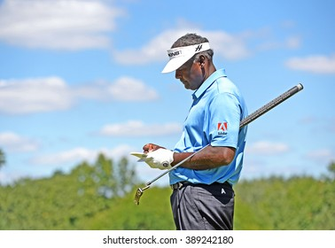 EDISON,NJ-AUGUST 28:Vijay Singh checks his score card during the second round of the Barclays Tournament held at the Plainfield Country Club in Edison,NJ,August 28,2015.