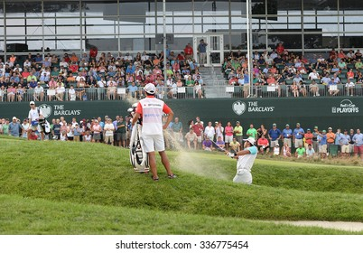 EDISON,NJ-AUGUST 30:Hideki Matsuyama blasts out of the sand trap to the 18th hole during the final round of the Barclays Tournament held at the Plainfield Country Club in Edison,NJ,August 30,2015.