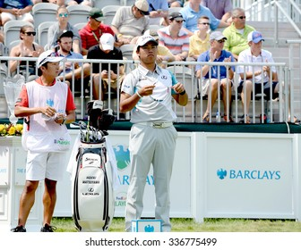 EDISON,NJ-AUGUST 30:Hideki Matsuyama (r) looks down the 1st Tee Fairway during the final round of the Barclays Tournament held at the Plainfield Country Club in Edison,NJ,August 30,2015.