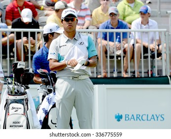 EDISON,NJ-AUGUST 30:Hideki Matsuyama takes a look down the 1st Tee Fairway during the final round of the Barclays tournament held at the Plainfield Country Club in Edison,NJ,August 30,2015.