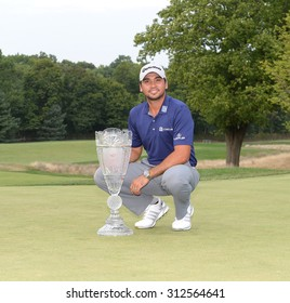 EDISON,NJ-AUGUST 30:Jason Day with the Barclays winner's trophy on the 18th green after the final round of the Barclays Tournament held at the Plainfield Country Club in Edison,NJ,August 30,2015.