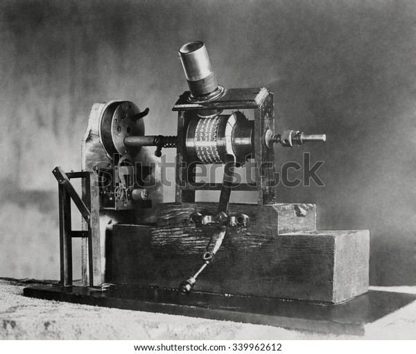Edison's First Movie Machine, the Kinetoscope, was a 'Talkie'. In 1886 the clockwork turned one shaft causing the small pictures to seem to move when viewed through the magnifying glass. Simultaneousl