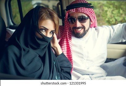 Edit Arabian Couple in the car near home