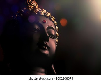 edited image of laughing buddha idol with abstract and glow lights/peaceful smiling buddha statue with focus on subject/background image of laughing buddha/isolated face of a smiling buddha statue