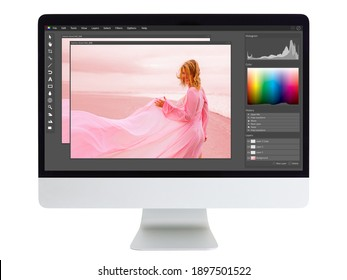 Editing and retouching photo on  desktop computer