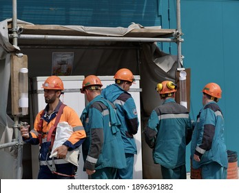 From the editor. Tobolsk; Russia; May; twenty; 2019: Construction site of a large plant. Workers drink water