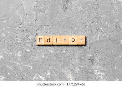 editor word written on wood block. editor text on table, concept.