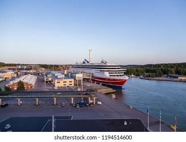 Editorial 08.09.2018 Turku Finland, MS Viking Grace at Viking Lines Turku Terminal loading passengers and cars and trucks on an evening