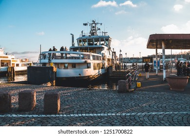 Editorial 11.17.2018 Helsinki Finland, Ferry that takes people to Suomenlinna fortress in sunset