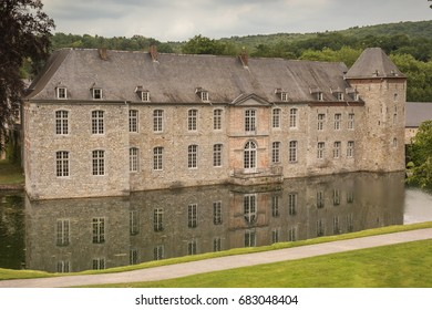 Editorial: ANNEVOIE, BELGIUM, June 17, 2017 - Frontal view of the Castle of Annevoie and its pond