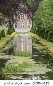 Editorial: ANNEVOIE, BELGIUM, June 17, 2017 - The castle of Annevoie and its reflection in the water of an artificial canal