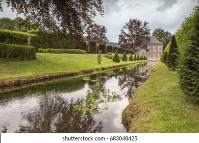 Editorial: ANNEVOIE, BELGIUM, June 17, 2017 - An artificial canal in the Gardens of Annevoie bordered by trees