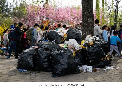 Editorial Beijing, China - April 2, 2017: The park visitors discarded trash, heap of a mountain.