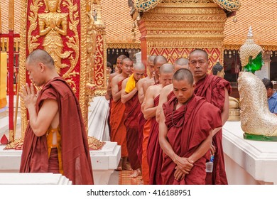 "EDITORIAL: Buddhist monks have a ritual in the temple ""Doi Suthep"" procession.Pray with priest procession around  chedi. Chiangmai, Thailand - April 11, 2015:"