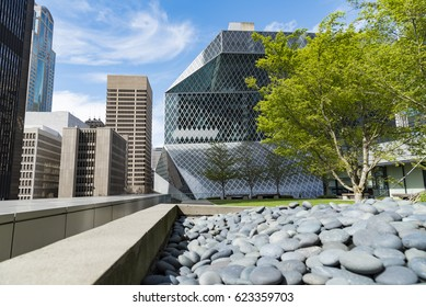 Editorial building and landmarks photography, downtown Seattle skyline and green space on sunny spring day circa April 2017