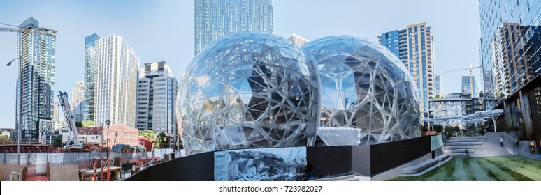 Editorial buildings and landmarks daytime view of the Amazon world headquarters campus featuring the Spheres terrarium globes located in downtown Seattle circa August 2017 panorama color.