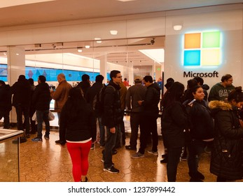Editorial: Connecticut, USA: Date 22nd Nov 2018: People waiting outside Microsoft store for Black Friday sale to begin at a shopping mall.