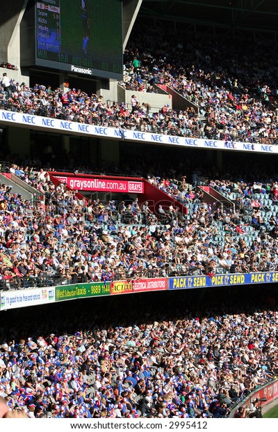 Editorial, crowd at Australian rules football stadium