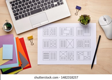 Editorial design. Graphic designer desk with magazine layout designs. Flat lay - Shutterstock ID 1482318257