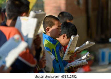 Editorial GanSu, China - May 18, 2017: Children in rural areas are standing outdoors and the children stand in a row to learn English.