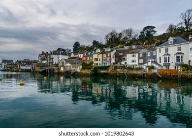 Editorial: Houses and potential logos. Fowey, St Austell Cornwall 02/06/2018. The houses along Fowey's main street back right onto the River , this is taken from the middle of the River Fowey.