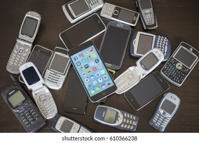 Editorial illustrative multiple cell phones old and new mobile technology