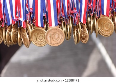 Editorial image: Gold medals awarded to the participants of Hervis Half Marathon run in Prague, March 28, 2008. Winner of the half marathon was Eliah Muturi Karanja from Kenya in time 1:02:08.