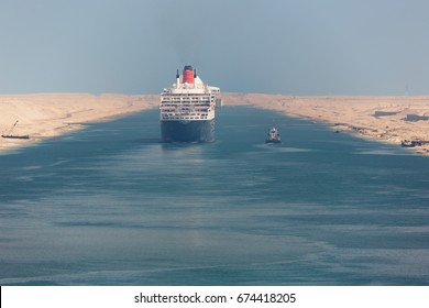 Editorial: ISMAILIA, EGYPT, April 27, 2017 - The Queen Mary 2 navigating through the Suez Canal in a ship convoy